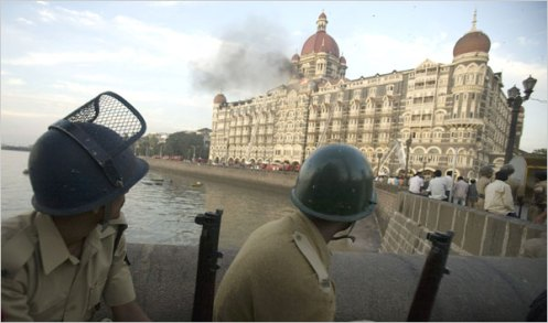 Police watched the Taj Mahal Hotel set ablaze by terrorists in Mumbai on thursday