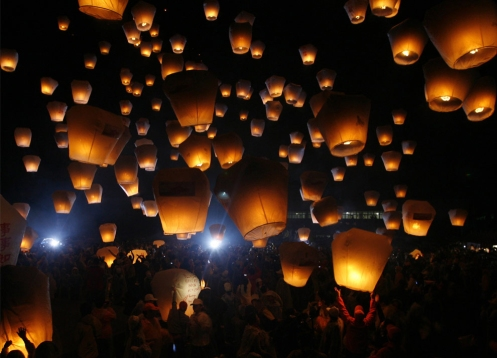elders of Pingsi - the tradition of releasing lanterns began during the Ching Dynasty when bands of outlaws frequently raided villages around Pingsi, forcing local residents to seek refuge in the mountains - The lanterns signal it's ok to come out of hiding