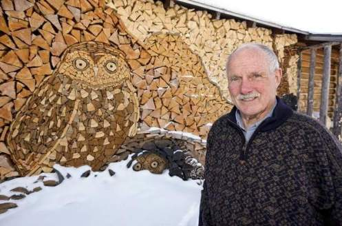 Gary Tallman used his firewood to create a mosaic of owls at his home near Monarch. - TRIBUNE PHOTO, LARRY BECKNER