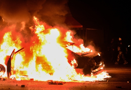 A police car is set ablaze during clashes with protesters following the grand jury decision in the death of 18-year-old Michael Brown in Ferguson