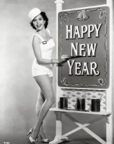 Ann Miller. Painting A happy new year sign.