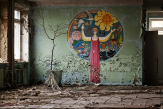 Nineteen years after the accident, the empty schools and kindergarten rooms in Pripyat - once the largest town in the Exclusion Zone with 50,000 inhabitants—remain a silent testament to the sudden and tragic departure. Due to decay, this section of the school building has since collapsed. Pripyat, Ukraine, 2005 (Gerd Ludwig/INSTITUTE)