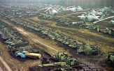 Vehicles contaminated by radioactivity lay dormant on November 10, 2000 near the Chernobyl nuclear power plant. All were irradiated during the clean-up operation. -Efrem Lukatsky