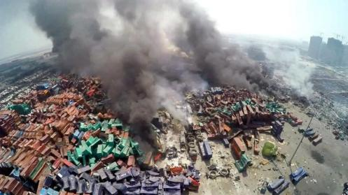 Aerial footage shows smoke billowing from burning containers the day after the blasts. (Xu Li)