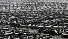 Hundreds of new cars awaiting export were reduced to shells by the flames. (Jason Lee)