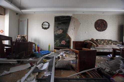 The shock waves from the explosions broke furniture, windows and other property in nearby residences. (Chinatopix via Associated Press)
